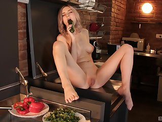 Solo unfocused Tiny Teen spreads her legs to play relating to food and toys