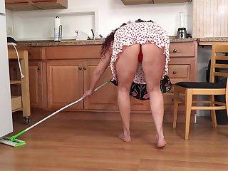 Sexy voluptuous housewife masturbating respecting the kitchen