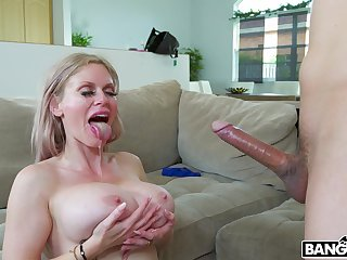Busty mature Casca Akashova gives a titjob and gets penetrated