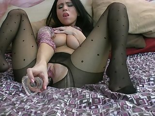 Film over be required of a good-looking solo model drilling her cunt up a glass dildo